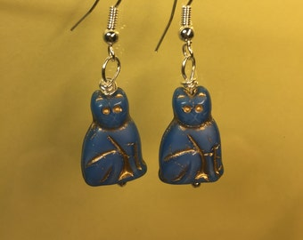 Blue with gold Glass sitting Cat earrings on silver french hook earwires.