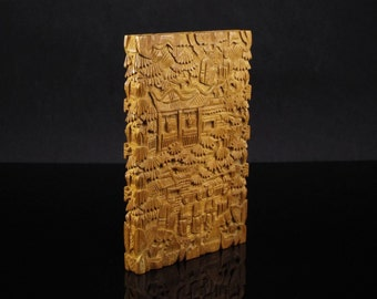 Vintage Chinese card case with intricate carvings of sandalwood from the mid-20th century.