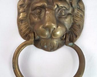 Cast brass lion's head door knocker, lacks mounting hardware