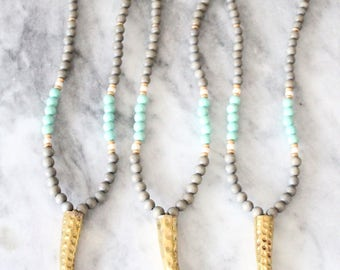 Hammered Gold Tusk Necklace