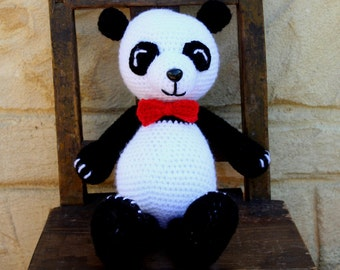 Handmade, crocheted toy panda bear for children and babies in black and white
