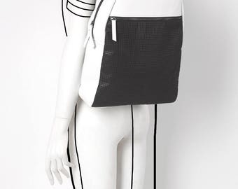 Leather perforated white and black backpack