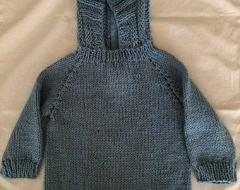 Knitted cobalt blue hooded baby sweater with back zipper size 12 months.