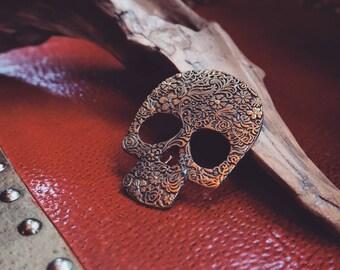 Intricate skull - brass ornament