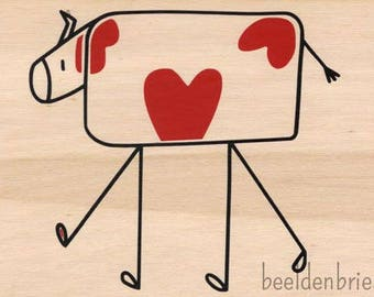 Wooden card with hearts cow