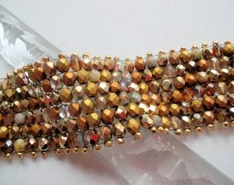 Bracelet beadwoven peyote bracelet firepolished czech beads gold Statement bracelet metallic beads gold