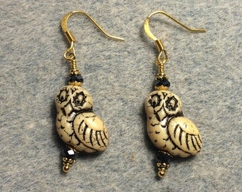 Tan with black wash fancy Czech glass owl bead earrings adorned with black Chinese crystal beads.