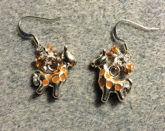 Silver and orange spotted enamel giraffe charm earrings adorned with tiny orange and tan Chinese crystal beads.