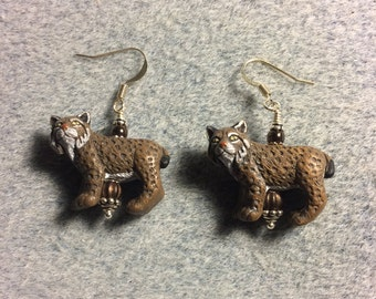 Brown ceramic bobcat bead earrings adorned with brown Czech glass beads.