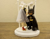 Wonder Woman and Batman with Banner Mr and Mrs Wedding Cake Topper