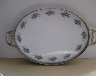 Magnificent French porcelain tray with a silver plated edge and handles.