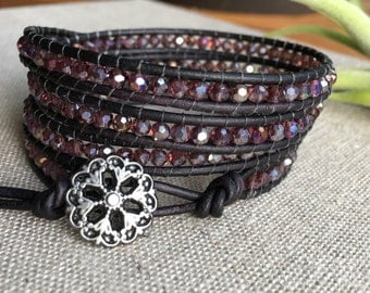 Wrap bracelet with Czech glass beads in plum and magenta tones, black leather and black flower button