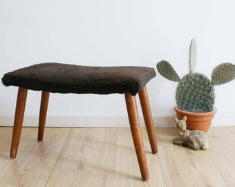 Vintage footstool with Brown plush upholstery. Wooden retro stool/process engineer