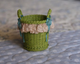 "A miniature ""wicker"" basket"