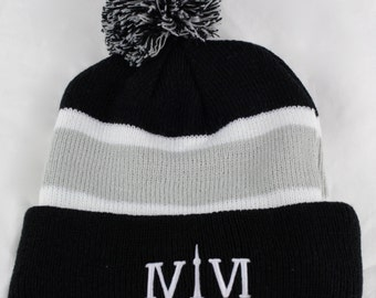 """Toronto 416 PomPom-Style Toques. The Roman Numerals Stand For 416, With The """"1"""" Resembling The CN Tower."""
