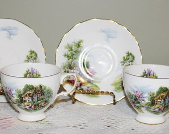 Matched Pair of Royal Vale Teacups and Saucers Cottage Scene Numbered Pinks, Greens, Blues Very Nice