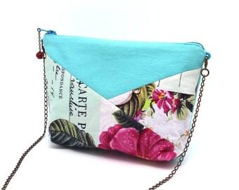 Trousse bleu lagon à fleurs roses