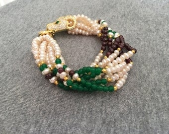 8 Strands of pearls garnets and jade