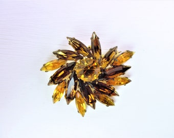 Crystal brooch, amber coloured starburst, two tone, rhinestone or cut glass.