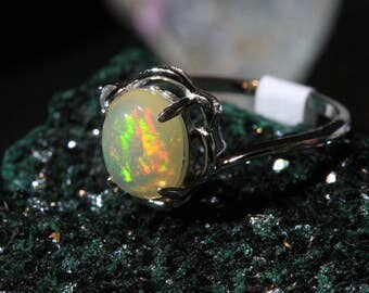 A simple yet chic 9x7 Natural Ethiopian Opal Ring set in sterling silver.
