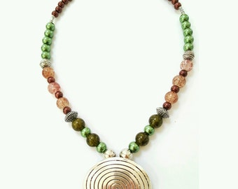 Silver swirl pendant necklace, beaded pendant necklace, brown and green beaded necklace, swirled pendant necklace, tribal style necklace