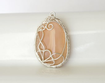 sterling silver wire wrap pendant with natural silky moonstone