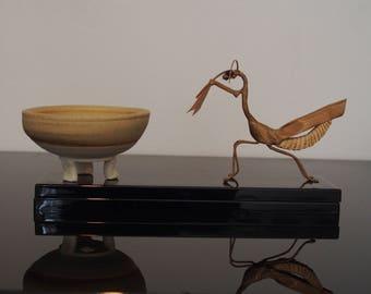 Bonsai, shohin or mame pot in golden sand on white