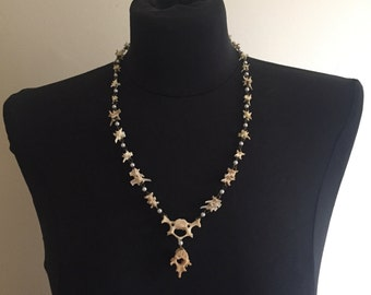 Vertebrae and pearl Necklace