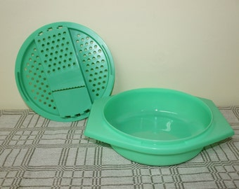 Vintage Tupperware Cheese Slicer, Grater or Salad Shredder Set with Green Rigid Plastic Bowl with Handles for Serving and Food Storage.