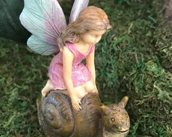 Miniature Fairy Riding on a Snail