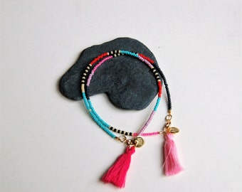Simple seedbead bracelet with tassel and goldfilled clasp and logotag