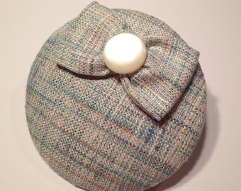 Fascinator light blue beige with Ribbon and mother of Pearl Color button