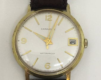 Caravelle Date Watch Gold Plated with White Dial 1960's