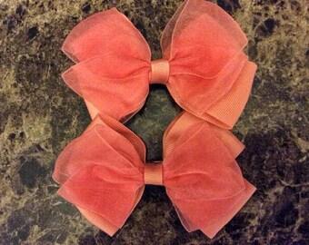 One (1) Coral Bow Hair Clip