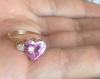 Gold ring with pink heart & side diamond.