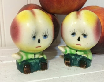 "Vintage Peach Head Salt and Pepper, not in a good mood seem to be saying ""Don't come any closer"""