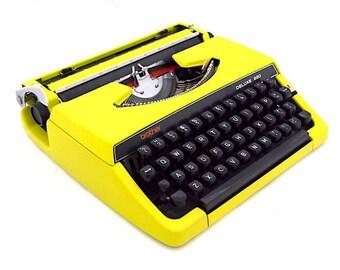 Brother deluxe 220 typewriter, brother typewriter, poison green typewriter, green or yellow, in working state, portable typewriter, vintage.