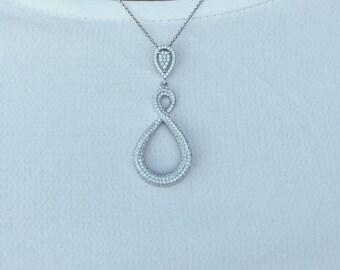 Infinite silver pavestone pendant