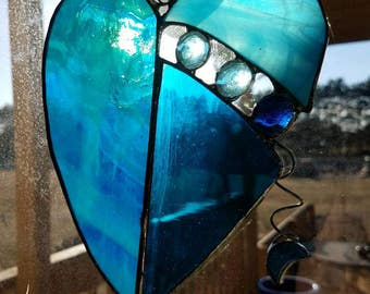 Blue stained glass heart with the moon