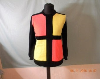 Handmade knitted ladies or gents geometric jumper.