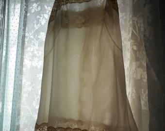 cream colored slip/nightgown with taupe lace at top and botton