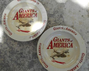 Two Vintage French Giants of America Metal Ashtrays