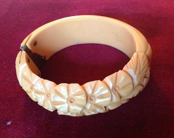 Vintage carved floral yellow Bakelite clamper bracelet