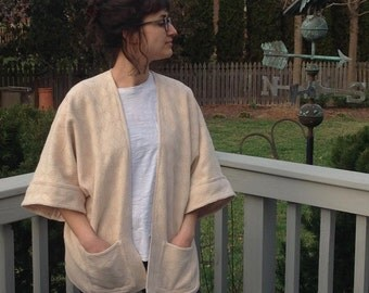 Kimono style, oversized jacket, unlined, cream and white jacquard cotton/acrylic blend, with pockets and cuffed sleeves, handmade