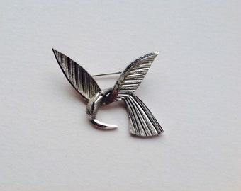 Bird brooch white metal