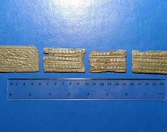 Ancient Bronze pad on belt.