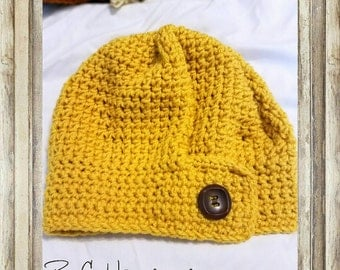 Yellow slouch hat with decorative button