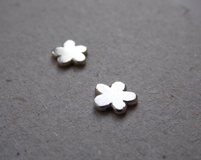 silver earring. Flower, moon, arrow, cloud, or flash pattern