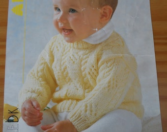 """Vintage knitting pattern for a baby's round neck cable and eyelet sweater. Knitted in double knit, chest 16-22"""""""