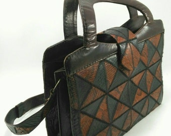Bag has black and Brown hand and snake leather Vintage